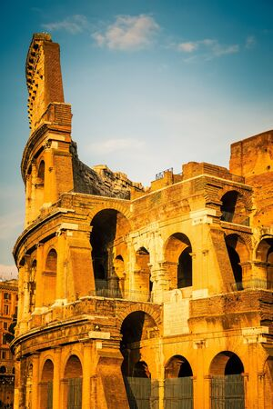 italian architecture: Colosseum at sunset in Rome, Italy