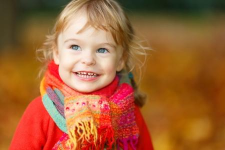 Little girl in the autumn park photo