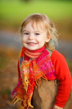 cute little girl smiling: Little girl in the autumn park Stock Photo