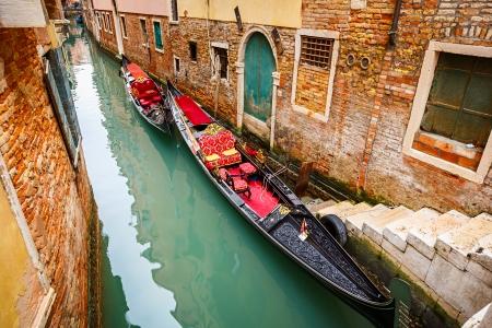 Gondolas on narrow Canal in Venice, Italy Stock Photo - 22410866