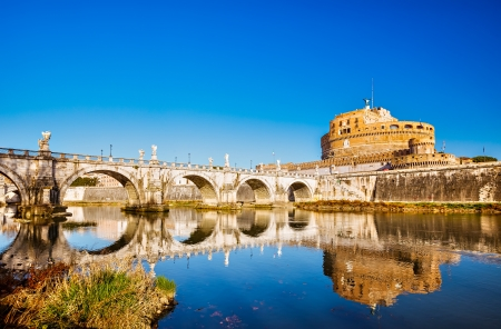 Bridge over the Tiber river in Rome photo