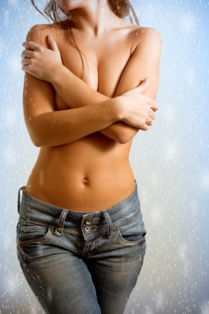 Torso of topless girl in a blue jeans photo