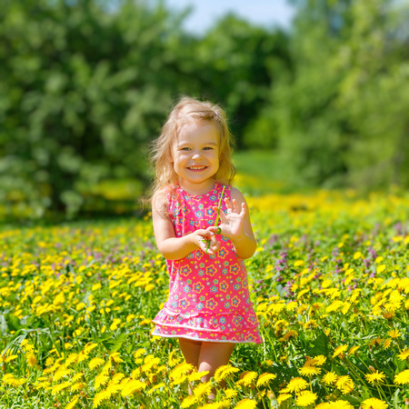Little girl playing in the spring park photo