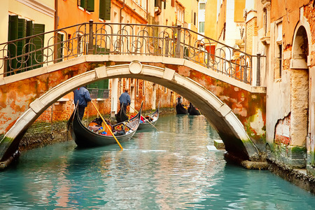 Gondolas on narrow canal in Venice, Italy photo