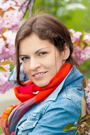 Young beautiful woman in sprng garden Stock Photo - 27306890