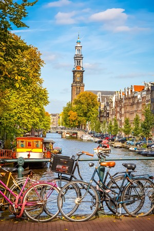 amsterdam canal: Western church and Prinsengracht canal in Amsterdam