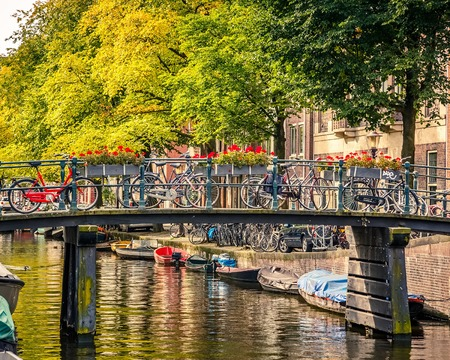 north holland: Bridge over canal in Amsterdam Stock Photo
