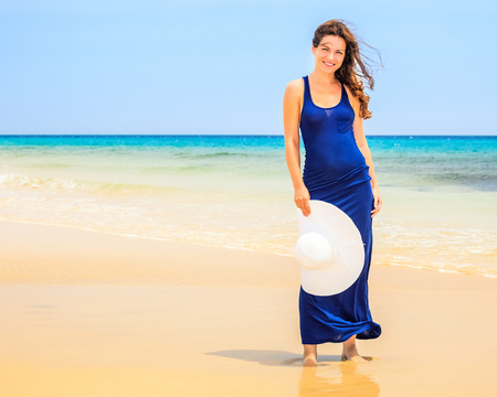 Young woman on ocean beach photo