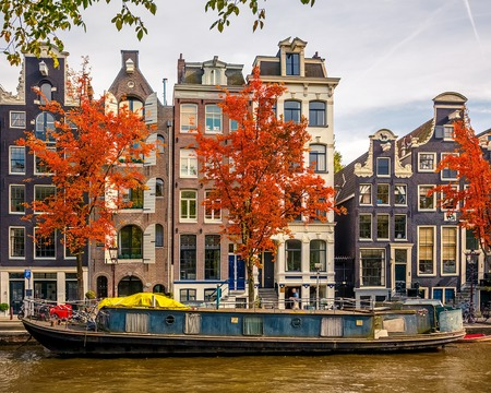 north holland: Buildings on canal in Amsterdam Stock Photo