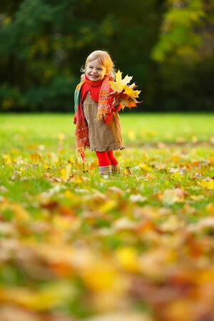 Little girl walking in the park photo