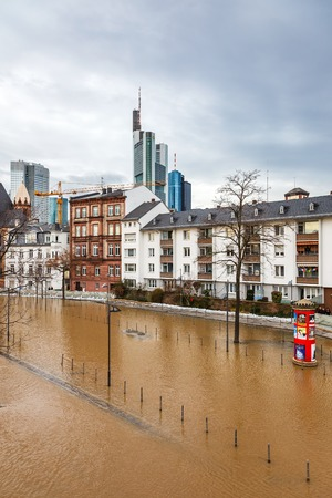 cataclysm: FRANKFURT- JANUARY 15 2011: Flood in Frankfurt am Main due to extremely high water in Main river.