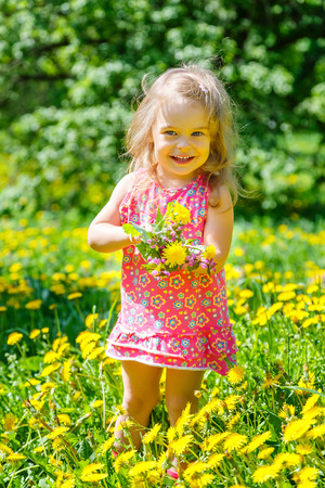Little girl with bouquet in the park photo