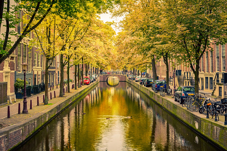 canal houses: Bridge over canal in Amsterdam Stock Photo
