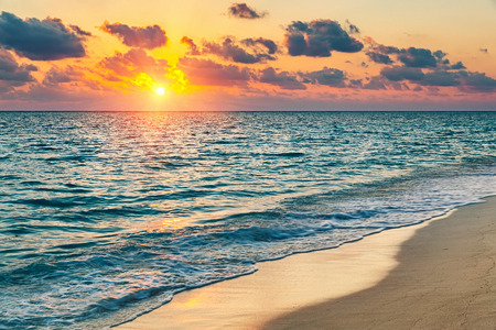 Colorful sunset over ocean on Maldives 스톡 콘텐츠