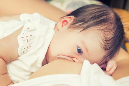 breastfeeding: Soft focus image of newborn baby breastfeeding