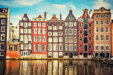 canal houses: Traditional old buildings in Amsterdam, the Netherlands Stock Photo