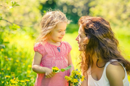 bright light: Mother and daughter in spring sunny park Stock Photo
