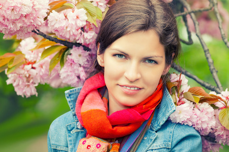 pretty face: Young beautiful woman in sprng garden Stock Photo