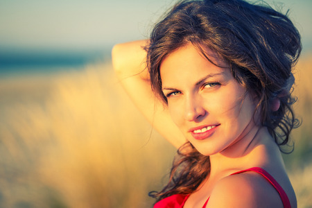 red and blue: Outdoor portrait of attractive young woman