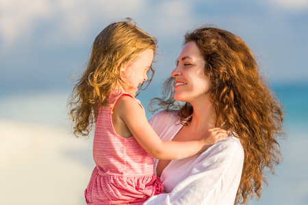 Portrait of mother and little daughter on the beach Stock Photo - 54802342