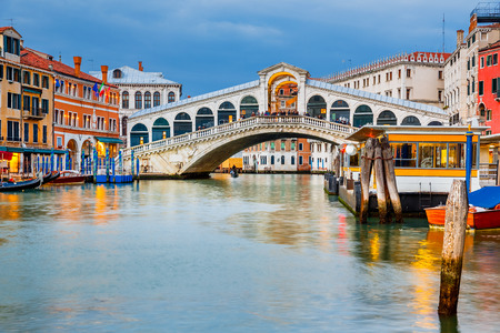 rialto bridge: Rialto Bridge at dusk in Venice, Italy Stock Photo