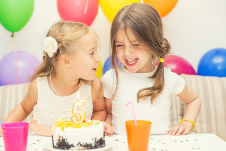 5 years: Birthday girl and her friend enjoying a birthday party