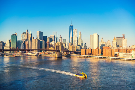 pier: Brooklyn bridge and Manhattan at sunny day, New York City Stock Photo