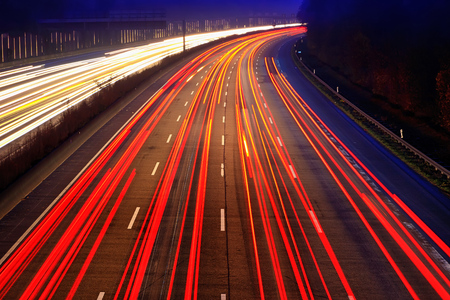 to bend: Night time traffic on highway Stock Photo