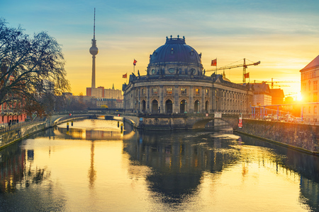 bode: Museum Island on Spree river and TV tower in the background at sunrise, Berlin, Germany
