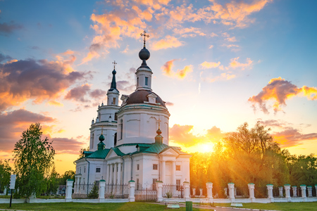 boldino: Clouds over Russian orthodox church at sunset. Bolshoe Boldino, Russia