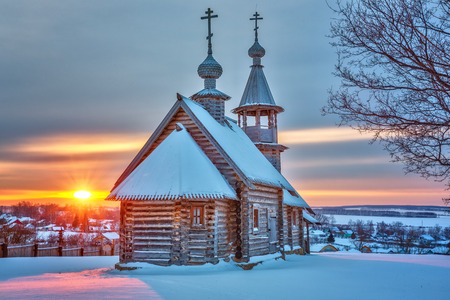 Small russian church at sunset in winter