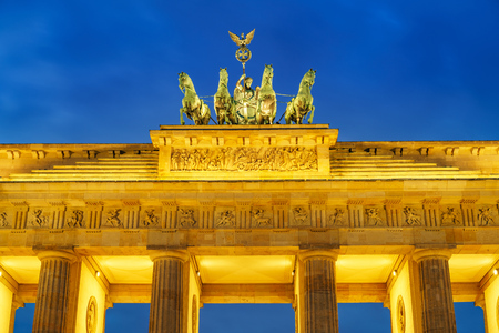Brandenburg gate at dusk, Berlin Stock Photo