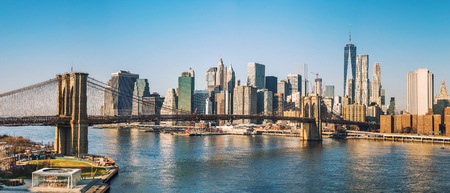 Brooklyn bridge and Manhattan at sunny day, New York City Фото со стока