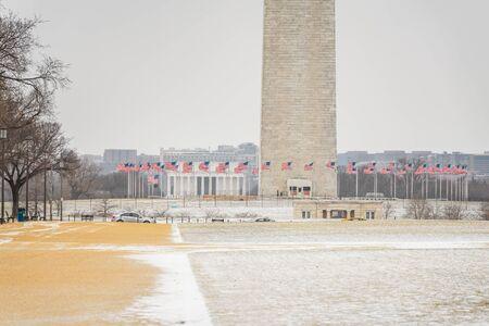 Flagpole near Washington Monument at winter, Washington DC