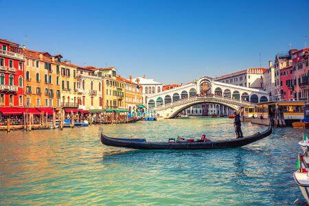 Gondola on Grand canal near Rialto bridgein Venice, Italy