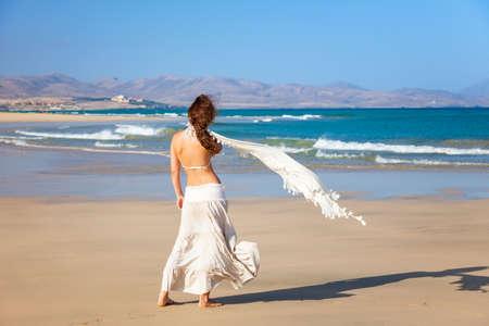 Attractive young woman enjoying the ocean beach on Fuerteventura
