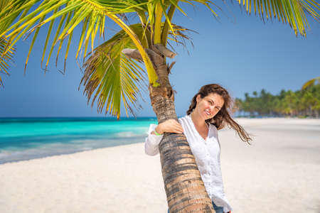Young woman on the beautiful ocean beach in Dominican Republic