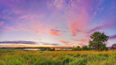Colorful sunset over lake in countryside at spring