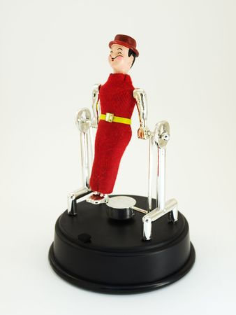 poppet: Toy like circus acrobat jumper on a clear background.