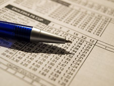 coefficient: Closeup of pencil on a betting wagers list. Stock Photo