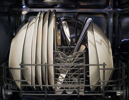 Interior of dishwasher and washed dishes. photo