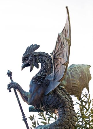 The statue of a dragon in the molten bronze somewhere in the east. photo