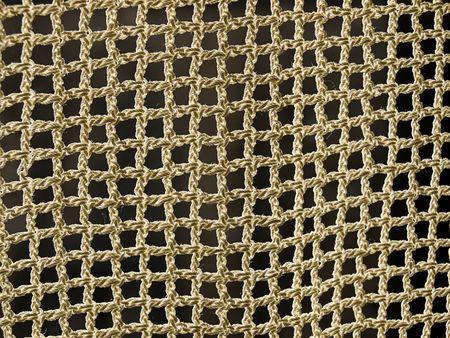 threadlike: Threadlike net with a back light and dark background. Stock Photo