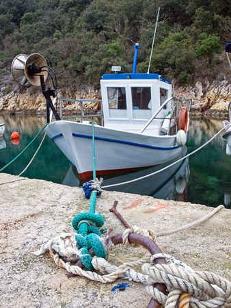Old fishing boat in a small fishing port. Stock Photo - 4509678