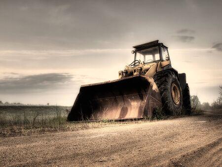 Big bulldozer at the building site.Monochrome toned.