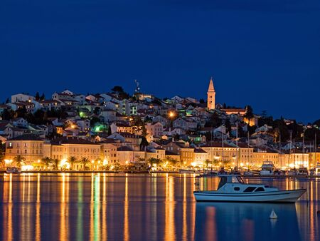 croatia: Evening View of the largest city on the island Losinj,Croatia. Long blend exposure. Stock Photo