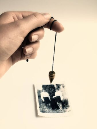 skeptic: Conceptual image about alternative searching of missing persons or communication with afterlife .  Toned image. Stock Photo