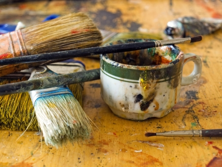 primitive art: Closeup of  a  mess on the painters table in some art studio. Stock Photo