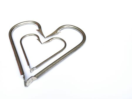 Heart in heart in the fishermans heart. White background with space for text. photo