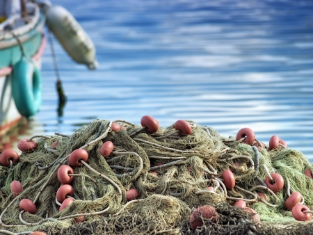 net fishing: Fishing nets on the waterfront after long fishing day. Stock Photo